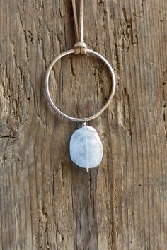 Artisan sterling silver and aquamarine necklace.  I have used a 2 mm sterling silver wire to forge, solder and then hammer a large circle, from which