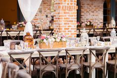 Casa Feliz: Stephanie and Mark's Moroccan Themed Wedding Reception | Whitewashed farm tables, French country chairs