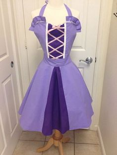 This is an adult size Rapunzel costume apron. Made of cotton.The skirt is a wrap style that provides full coverage in back yet is adjustable to fit many sizes. Designed to overlap in back with ties that go through buttonholes on the waist belt then tie snugly in back. A perfect way to adjust for many sizes. Skirt length in 21 inches from waist. Waist is approximately 45 with two ties that are each 30. Smaller women will need to fold the sides in prior to tying to get a clean look in back…