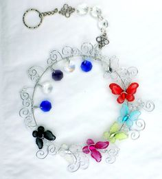 Butterfly sun catcher. Made with a choice of colour butterflies. Measures 20cm in diameter. With beautiful sun crystals.