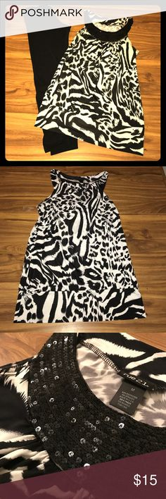 Zebra Print Sequin Tank Top Multipurpose Tank! Dress with leather leggings and killer heels for a girls night out. Or add a blazer with some slacks for a business finish. Either way, your going to look amazing! Sequins are all in tact and in excellent condition. Only worn once. Rue 21 Tops Tank Tops