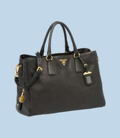 "A very elegant black Prada Tote handle bag which is made from deerskin.  The bag can be used as a sholder bag for the casual days or you can remove it and just use the handles for the corporate look.  This is a cheaper alternative compared to the Hermes and a very good one too.  The dimension are L 15.75"" H 11.81"" D 6.69"" which is enough space to place an A4 folder.  There are other colors, but the black makes it easy to match most of my clothes."