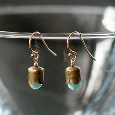 alain in blue - gold and bronze earrings by elephantine. $26.00, via Etsy.