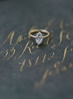 Vintage marquise-cut gold engagement ring: http://www.stylemepretty.com/louisiana-weddings/new-orleans/2016/09/22/meet-mysterieuse-dame/ Photography: Katie Grant - http://www.katiegrantphoto.com/