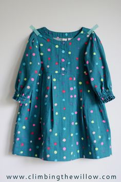 Climbing the Willow: sew it all series - every girl needs a polka dot dress. Love the snaps, pleated sleeves, double row of elastic, fabric!