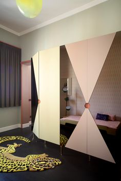 Lacquered MDF and pink mirror wardrobe, stacking bed by Muller Mobelweskstatten, Eublepharis carpet by JIWONXKIM, blown suspended lamp by & Tradition, Tam Tam floor lamp by Marset.