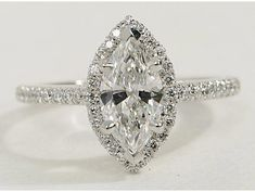 I can keep my original diamond with it's history but with a modern look wedding rings marquise Marquise Cut Halo Diamond Engagement Ring in White Gold Halo Diamond Engagement Ring, Diamond Wedding Rings, Vintage Engagement Rings, Diamond Rings, Diamond Cuts, Halo Rings, Diamond Jewelry, Bling Bling, Expensive Wedding Rings
