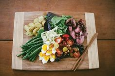 New Appalachian Salad Niçoise. Salad Niçoise is a French salad, but we've given it a little bit of a twist, taking advantage of some of our farmer friends' products and adapting it to our own tastes. It does take time to prepare, but once everything is prepped, it's easy to throw together. Invite eight or ten of your closest friends, bring out the wine, and have a BIG time!  Recipe by Chef Dale Hawkins of Fish Hawk Acres, Rock Cave, West Virginia. Photo by Lauren Stonestreet.