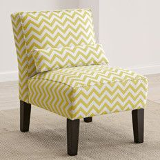Use an accent chair in a sunny yellow hue to brighten up a forgotten corner.