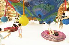 """Giant Playground Made Of Crocheted Yarn; Takino Suzuran Hillside National Park """"Rainbow Net"""" by crochet artist Horiuchi MacAdam"""