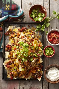 These five-ingredient nachos are a cinch to make for a large crowd. Bake a batch for your next party and serve with an array of topping options, like cilantro, jalapeno peppers, sour cream, and salsa.