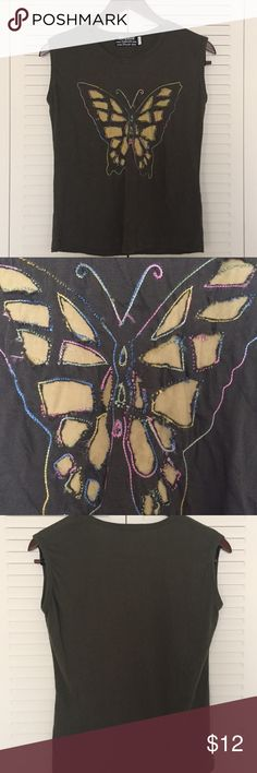 ♨️Butterfly Boutique Sleeveless Shirt NWOT Army/Olive green, sleeveless, beautiful & colorful hand sewn butterfly design. See pix for details, inside & out. 100% cotton, made in Nepal. Size Large but fits like small. NWOT from Boutique. NEVER worn. I washed this once by hand & hung to dry. It looked like a small deodorant smear was on it but that is now gone. Offers accepted. 💜 See last pic for tiny flaw in seam. Rayzor Tops