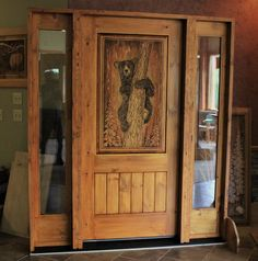 Carved bear door with v-groove plank & sidelites. Door unit is from knotty pine. Hand Carved, Carved Wood, Knotty Pine, Wooden Doors, Door Design, Plank, Carving, The Unit, Bear