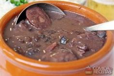 Feijoada (black bean stew) is the national dish of Brazil – and is especially popular in Rio de Janeiro. Latin American Food, Latin Food, Feijoada Light, Sauce Pour Porc, Black Bean Stew, Black Beans, Comida Latina, Portuguese Recipes, Meat Recipes