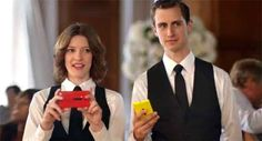 """Microsoft mocks Apple-Samsung rivalry in latest Lumia ad    Microsoft has rolled out a new television commercial for Nokia Lumia 920. In this ad, Microsoft seems to be mocking the rivalry between Apple and Samsung to drive home the """"Switch to Lumia"""" message. The ad opens with a wedding ceremony in progress. As soon as the bride and groom are about to exchange their vows, everybody at the wedding takes out their smartphones and phablets to capture the moment."""