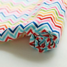 Hey, I found this really awesome Etsy listing at http://www.etsy.com/listing/108874964/baby-blanket-rainbow-zig-zag-backed-with