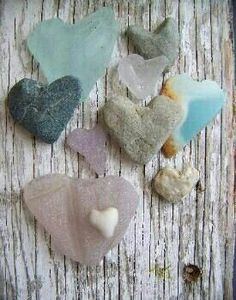 Rocks and sea glass and weathered wood.