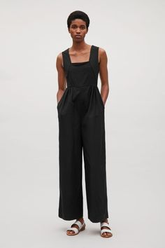 COS image 1 of Wool jumpsuit with elastic waist in Black