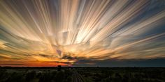 Usually to experience a sunset in its entirety, one must devote a couple of hours to watching the majestic motion of the sky as the sun floats downward until it's completely out of view. Thanks to photographer Matt Molloy, we can now experience the visual power of the setting sun in a single image.