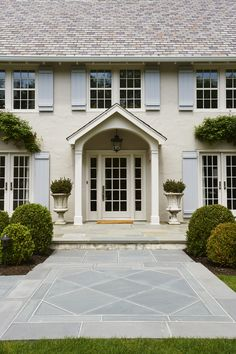 boxwoods | stone patio