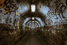 #brick wall #graffiti #lights #passage way #pavement #tunnel #underground #underpass #vandalism