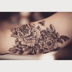 adding a bee.  black and grey floral tattoo