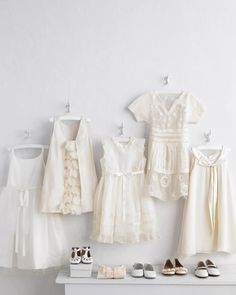 """Frocks for the junior set come in a wide array of adorable styles, from cutting-edge to Spanish-inspired, ballerina to bohemian. To give the ensemble dimension, pair your flower girl's white dress with an ivory cardigan and shoes. Clockwise from left: """"Ballerina"""" tulle-skirt dress,US Angels. Silk taffeta petals dress (#19831), J.Crew. """"Spanish Princess"""" dress, Flora and Henri. """"Hut Up"""" merino-wool and silk dress, Makie. Satin bow dress, Us Angels. """"Vicky"""" flats, Elephantito. """"Hillary"""" satin…"""