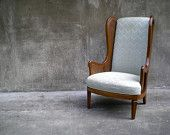 vintage cane wingback chair with chevron stripe upholstery.