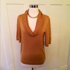 NWOT BCBG MaxAzria Gold Top NWOT Goldenrod BCBG MaxAzria Top.  This top is very slimming and works great with or without a belt.  Size Medium BCBGMaxAzria Tops