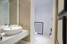 Marbled Water Closet Next To Floating Vanity Area
