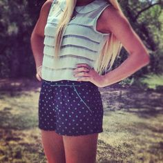 High waisted polka dot shorts paired with a mint Peter Pan top!