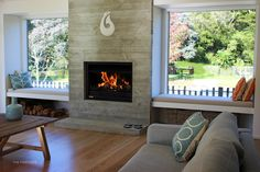 Jetmaster Open Wood Fire by THE FIREPLACE Wood Burning Logs, Freestanding Fireplace, Timber Cladding, Open Fires, Brick Fireplace, Fireplace Ideas, River House, Firewood, Architecture Design