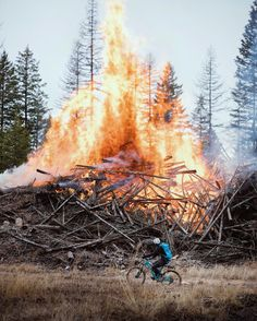 Morning bike rides in the woods of Montana. The weather was 36 degrees but 100 yards from this slash pile started by the Forest Service it was hot enough to turn my cheeks red. @alexstrohl nearly melted riding by.