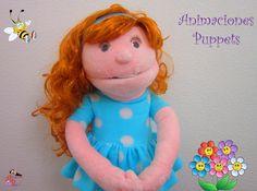 Títere niña de 50 cm, color rosado, vestido de color celeste con lunares blancos, cabello marrón. (código NA-23)