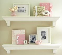 Classic Shelving #PotteryBarnKids  with the McKay silver vase the silver block bank a photo of grammie and a couple of child hood books