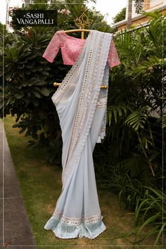 Gorgeous ice blue color designer saree and blush pink color designer blouse with hand embroidery work. They make sure there s something about each saree that ignites the imagination ! For Order (or) Enquiry What s app on:- 7993483640 / 9010906544 Designer Sarees Wedding, Saree Wedding, Saree Blouse Patterns, Saree Blouse Designs, Saree Gown, Sari Dress, Chiffon Saree, Desiner Sarees, Farewell Sarees