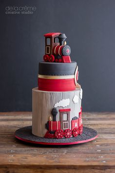 Tiered cake with a train topper