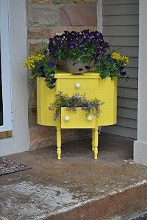 Paint an old piece of dusty furniture from a tag sale or flea market with a pop of color - love how they used it outside for flowers and plants