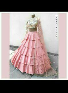 Crop top and a high waisted layered skirt is the easiest majestic outfit pick for summers. Would there be a need to mention that the two most favourite colour picks for this season ivory and blush pink team up to make it just perfect!ed 04 March 2018 Lehnga Dress, Lehenga Choli, Indian Wedding Outfits, Indian Outfits, Indian Designer Outfits, Designer Dresses, Indian Gowns Dresses, Lehenga Designs, Indian Attire