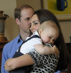 Favourite snap: George snuggles up to Kate in the photo she chose as the best from the Roy... http://dailym.ai/S50oOs#i-acf70e94
