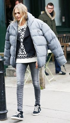 Layer your puffy jacket over a sweater and moto jacket, for a Cara Delevingne–inspired look. With the extra layers, you won't freeze when doing the fashion-girl drape with your puffer.