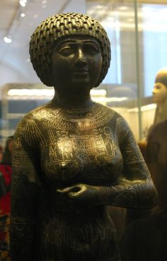 Statue of the princess - priestess Takushit. Found on Kom Tourougka, near Lake Mareotis, south of Alexandria, in 1880. Copper alloy with precious metal inlay. End of 25th Dynasty, approximately 670 BC.The statue had a ritual votive, and funerary use.  The woman's name means 'the Ethiopian' and may refer to her relation or marriage to an Ethiopian. Her father was Akanosh II, great chief of the Ma tribe from Libya. The figure's characteristic garment is executed with inla…