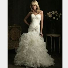 Allure Couture Mermaid Wedding Gown OBO PLZ SHARE! Worn once bridal gown. 70% off! Taken in to fit a std size 12. corset back is very forgiving to go up or down a size. Height with shoes when worn was approx 5'6 and hit the floor. Bussel for train. Silver beadwork and sweetheart top add just the right amount of romance. Mermaid fit is very flattering for a curvy woman, and  gives illusion of curves to a less shapely figure. Hasn't been dry cleaned, needs professional dry cleaning for typical…