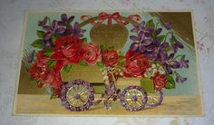 Gold Car Filled With Res Roses, Violets and Lilies of the Valley Antique MAB Postcard by KrisGoesPicken on Etsy https://www.etsy.com/listing/438216357/gold-car-filled-with-res-roses-violets
