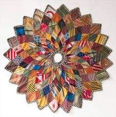 Super cute patchwork kaleidoscope Christmas tree skirt out of old ties. Yule, Crazy Quilting, Diy Laine, Necktie Quilt, Old Ties, Handmade Christmas Tree, Beautiful Christmas Trees, Tree Skirts, Holiday Crafts