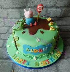 George from Peppa Pig cake for a boy. Made by Nicolaz cakes in the uk