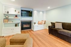 Add fireplace with built-ins on either side and tv above