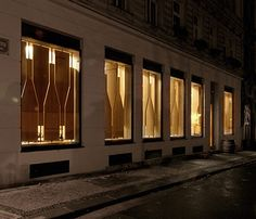 Red Pif Restaurant and Wine Shop by Aulík Fišer Architekti wine bottle shutter facade