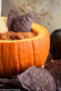 Queso Dip with Sausage - served in a pumpkin. Sign up for more quick, healthy recipe at http://eepurl.com/bgGhFT