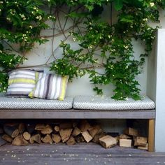 Double up your furniture in a small space - here a built-in bench doubles as a log-store